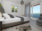Bedroom on 1st floor with double bed and sofa bed, exit to the balcony
