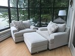 two oversized couches on sunroom
