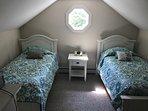3rd floor bedroom with twin beds