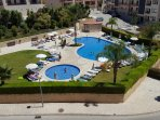 Beautiful pool area with children's pool, mature garden and toilets