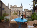 A glass of wine on the lovely terrace with a view of the old chateau - a perfect way to relax!
