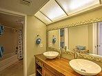 Freshen up in the pristine master bathroom.