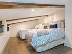 Comfortable sleeping for 3 in the loft equipped with queen and twin beds.
