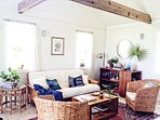 The beachy-bohemian living room is a great place to start or end your day of fun in the sun!