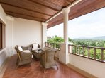 Bedroom 3 private balcony (25m2), wicker furniture, panoramic view