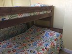The third bedroom is quite small but it has a twin over full bunkbed with under the bed storage