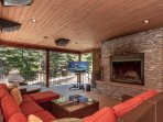 The lower patio is the perfect relaxing spot near the fireplace.
