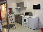 Kitchenette et lave-linge à votre disposition