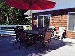 Upper patio with propane BBQ and outdoor seating for 8