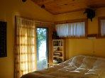 Master Bedroom with Patio Door opening to Lake Shore