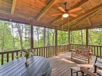 The covered porch of this 4-bedroom, 3.5-bathroom vacation rental cabin in Sapphire is the ideal place to spend...