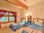 The second bedroom provides a set of twin-sized-beds as well as a twin-over-twin bunk bed.
