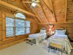 Two guests can sleep in the fourth bedroom, which has a set of twin-sized beds.