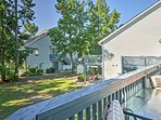 Enjoy the pleasant South Carolina weather from from your private balcony at this vacation rental condo in Little River.