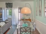 The glass dining table adjacent to the living room can seat 6 guests.