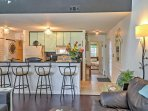 The condo is 1,200 square feet and boasts an open floor plan.