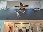 There are several paddle fans in the home which help keep the space cool all year long.
