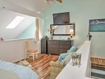 Head upstairs to the master bedroom to watch TV.