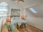 Two guests can sleep comfortably in the master bedroom's queen-sized bed.