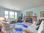 The cozy living room offers a gas fireplace, flat-screen Satellite TV, and fantastic views of the surrounding rolling...