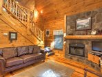 Relax on the couch next to the wood-burning fireplace.