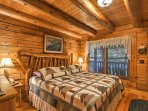 The master bedroom offers a king-sized bed and access to the deck.