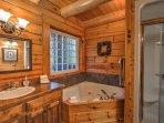 Look forward to soaking your cares away in the master bathroom's bath tub.