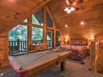 Upstairs in the loft, you'll find a pool table and a queen-sized bed.