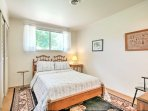 Those sharing this room will enjoy soft linens over a plush full bed.