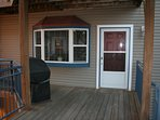 Entrance. Grill on wrap around deck.