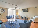The living room features a plush couch, 4 armchairs, and a flat-screen cable TV and is a pleasant gathering place for...
