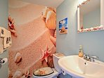 Feel like you're on the beach in the powder room.