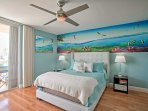 Dive into a queen-sized bed in the ocean themed bedroom with a flat-screen cable TV.