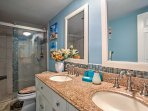 The full bathroom offers a walk in shower and his and hers sinks.