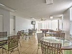 The common area features a flat-screen cable TV, pool table, and ample seating.