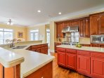 Prepare family feasts in the gourmet kitchen to enjoy in the nearby dining room with seating for 8.
