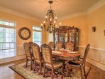 Host a formal dinner at the exquisite dining room table.