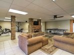 The additional living space in the basement includes a fireplace, flat-screen TV, workout room, kitchen, bedroom, and...