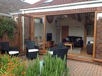 Cosy modern Bungalow with all facilities, lounge with Bi fold doors opening onto large garden