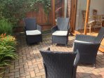 Sunny seating area surrounded by fragrant garden