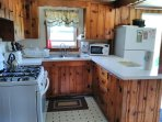 gas stove, toaster, microwave, coffee pot, full size frig, crockpot, dish suds, scrubby, linens
