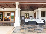 80m2 patio furnished with wicker furniture, facing the swimming pool