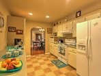 the large, fully equipped kitchen offers all of the comforts of home.