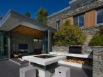 the outdoor fire pit table and BBQ provide great holiday amenities