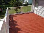 One side of rear decks, have 4 deck chairs, and a table with 4 other chairs on decks