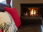 the cosy gas fireplace providing the perfect après ski ambience