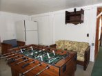 Bottom floor game room with foosball and air hockey - not climate controlled