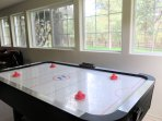 Air Hockey Table overlooking Backyard and Forest.
