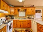 The kitchen features beautiful wooden cabinets.