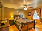 Two guests will sleep well at night in the queen-sized bed in the master bedroom.